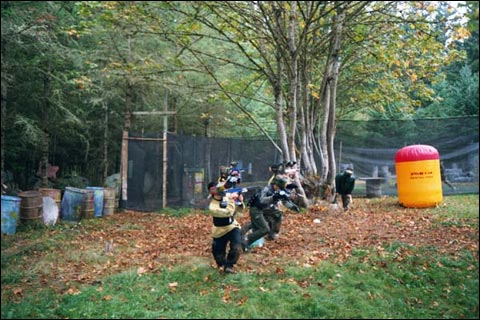 Paintball Team starts game at Splat Action Paintball Field in Moalla, Oregon.