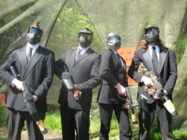 Paintball players wearing suits and ties